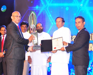 Left to Right: Mr. Rashid Hameed, Director Thermo Plastics receiving the award from President Maithripala Sirisena with Mr. Dharma Bandula, AGM Production/Logistic, Thermo Plastics