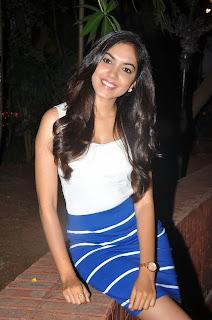 Ritu Varma in Blue Skirt and Lovely White Tank Top Must See at Kiraak Audio release Function