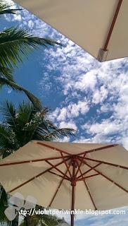 beach umbrellas blue sky