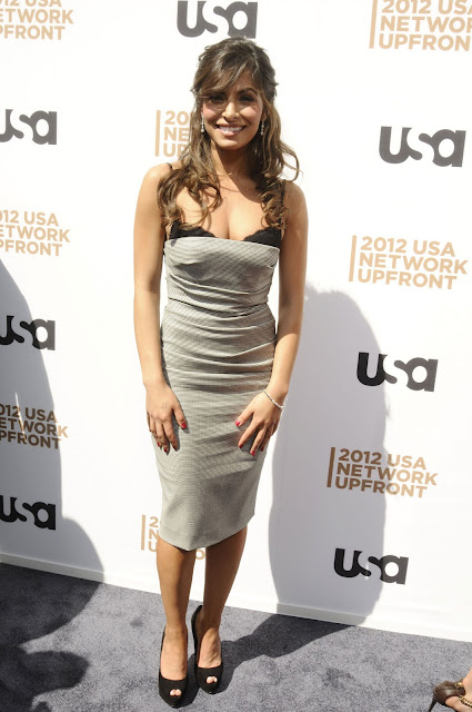 SARAH SHAHI posing on the red carpet at USA Network Upfront Presentation 2012
