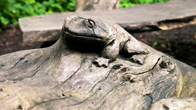 carving of a frog