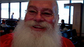 Santa Claus Is In The Air, At An Airport