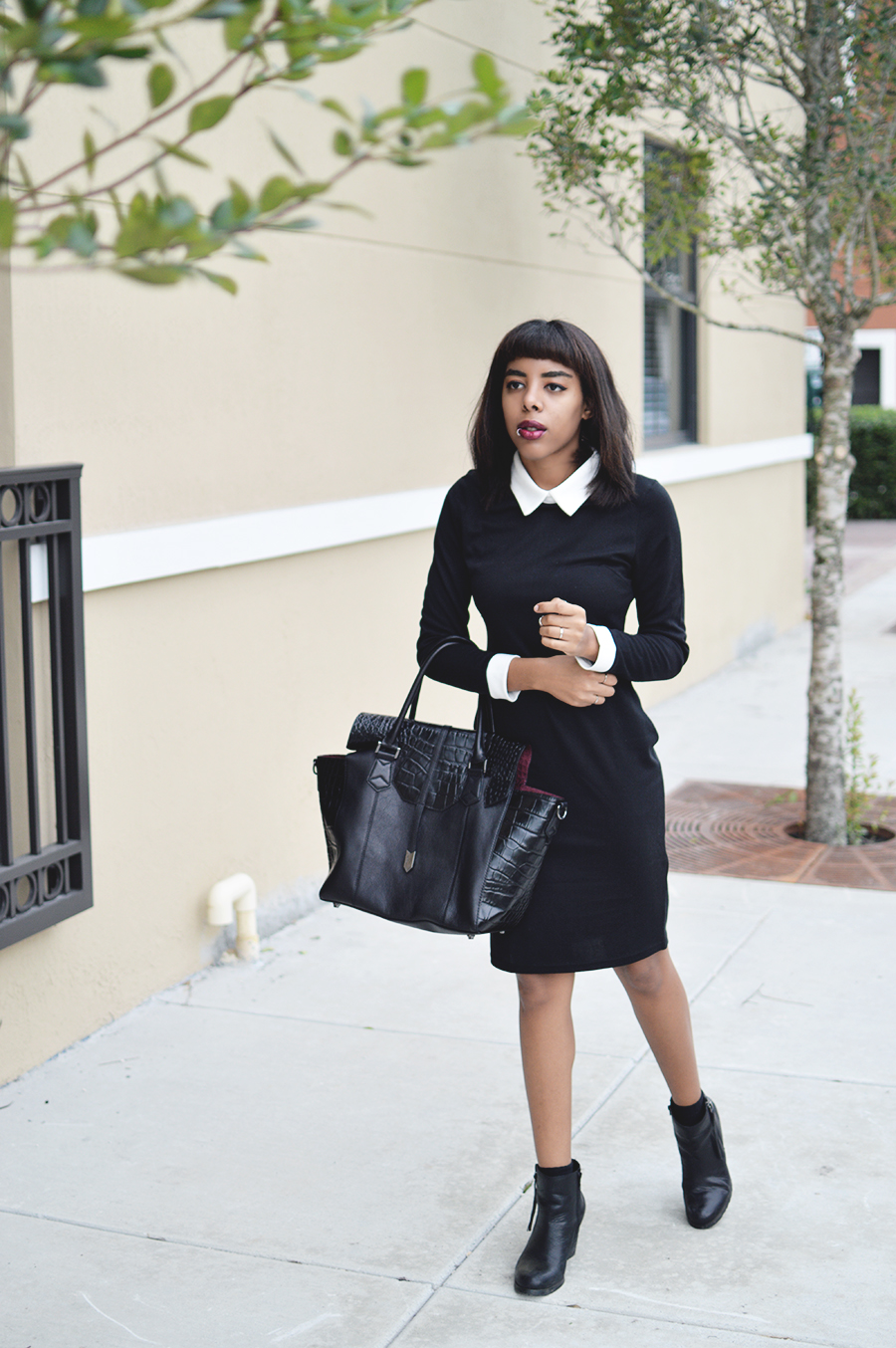 Minimalist Indie Fashion Blogger Anais Alexandre of Down to Stars in a Zara dress with a Treesje bag and boots