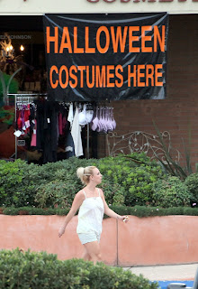 Britney Spears in front of a  Halloween store