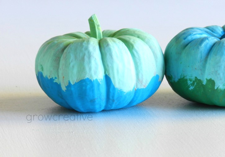 Green and blue painted pumpkins