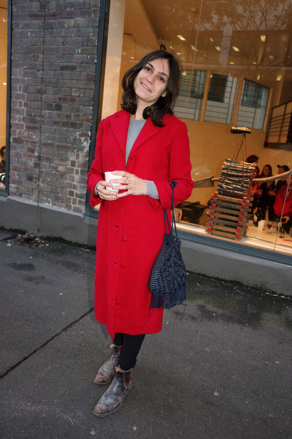 Red winter coat, worn RM Williams Boots, Black leggings grey marl long sleeve tee, art student style.