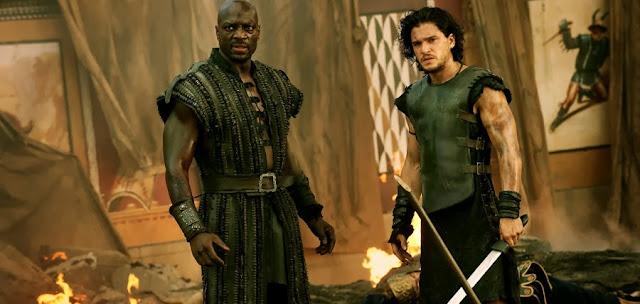 Adewale Akinnuoye-Agbaje şi Kit Harington în Pompeii