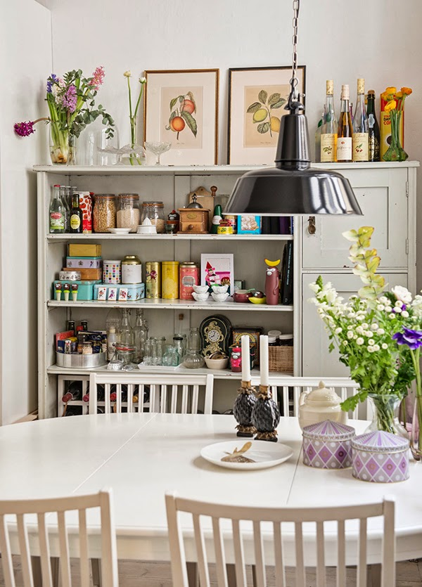 pantry area! Those little purple boxes on the dining table are just