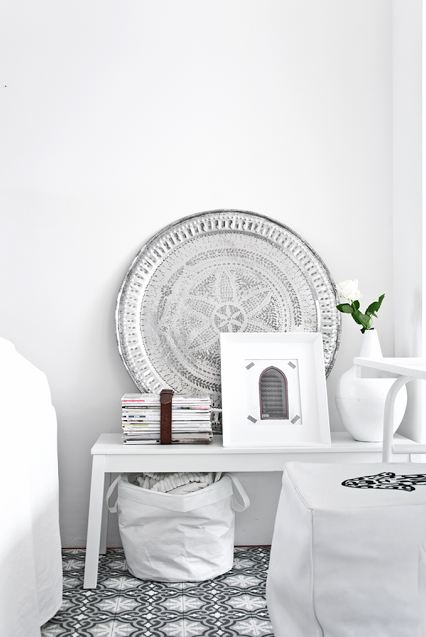 white living room with black and white moroccan tiles close up