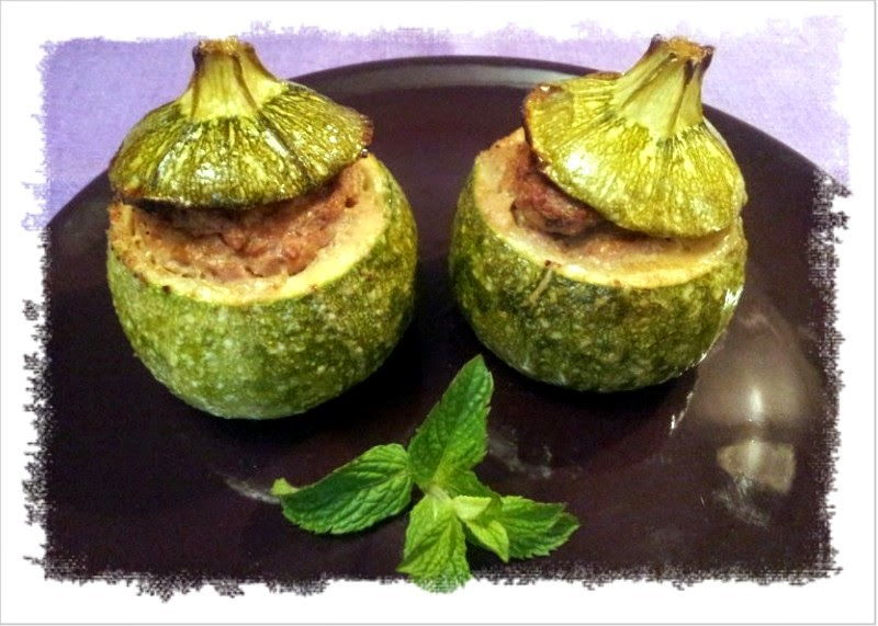 zucchine tonde ripiene e gratinate in forno.