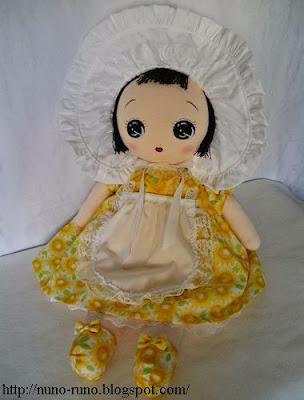 Bunka doll in yellow dress