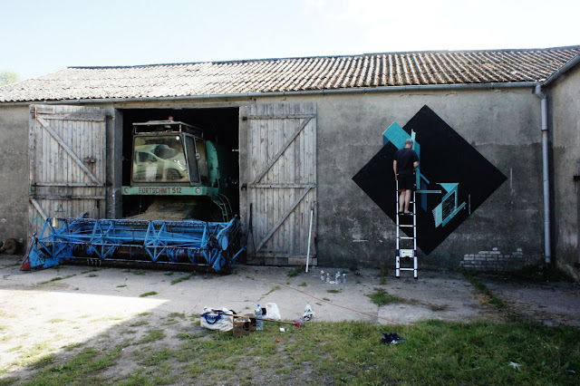 Street Artist Seikon At Work on a new mural in parchowo