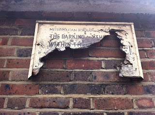 Battered, car parking sign in Shoreditch, London EC2