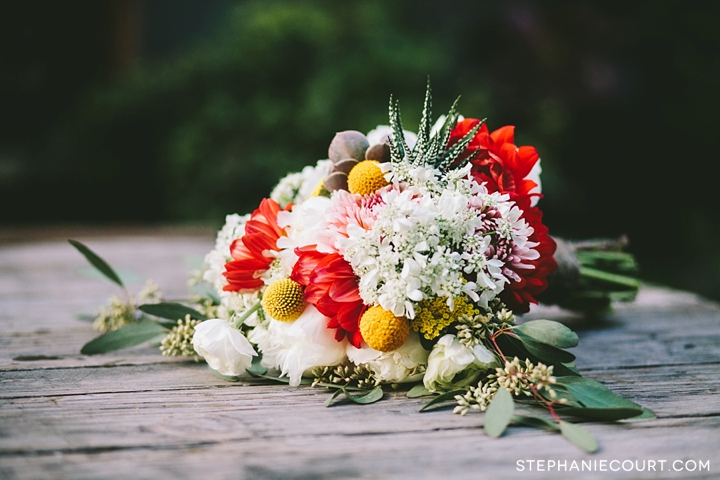 coral and white bridal bouquet with succulents