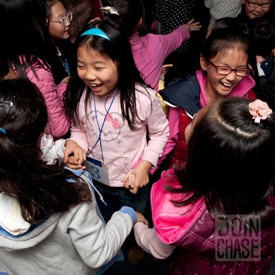 A group of Korean elementary students dance during a school field trip to an English Village in South Korea.