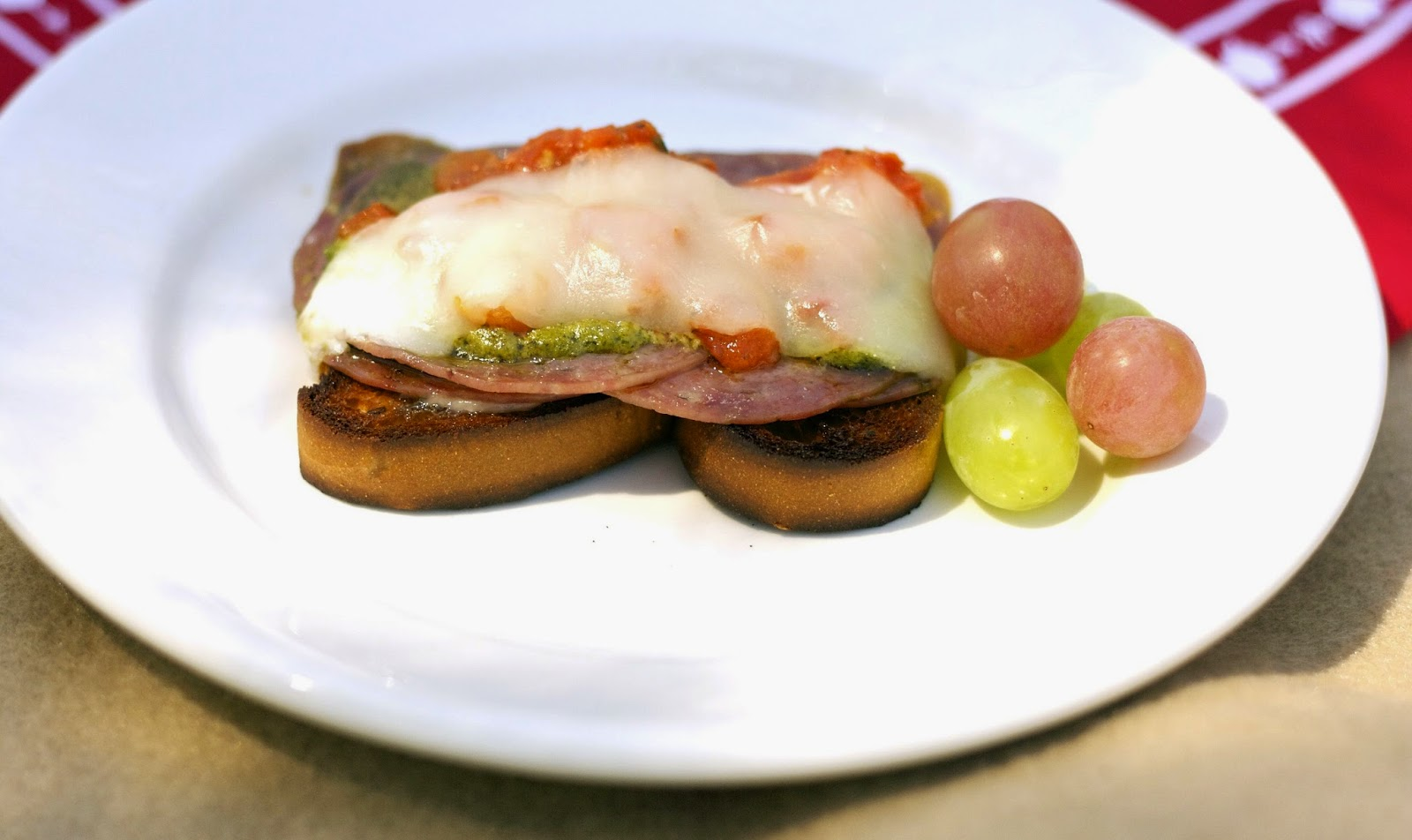 "... Italian"" Salami, roasted tomatoes, pesto, and melted provolone cheese"