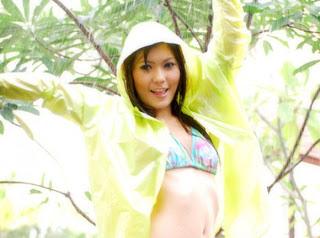 beautiful Chinese girl taking bath in rain