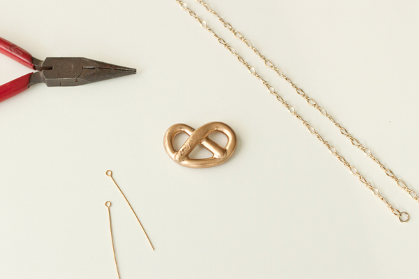 A golden pretzel necklace DIY made from clay