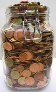 Een bokaal vol kleingeld, wat ermee doen?
