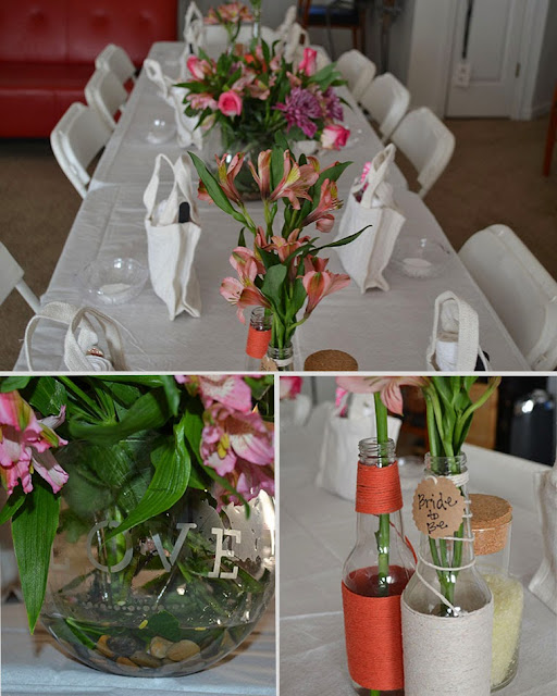 flowers on table, love etched vase, yarn wrapped bottles