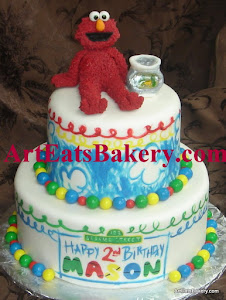 Two tier Elmo's World Seseame Street hand painted birthday cake with fondant Elmo and fish bowl top