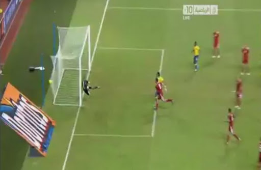 Gabon player Bruno Zita scores from a free-kick deep into stoppage time against Morocco