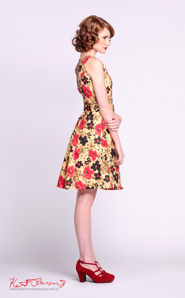 Yellow dress with bold floral pattern, red shoes, full length shot with model - Vintage Fashion - Studio White Background -