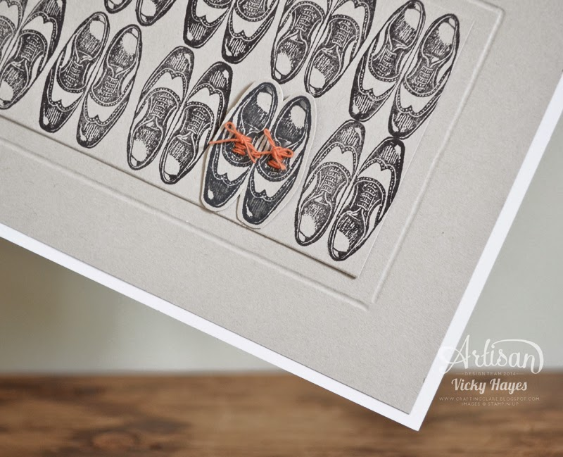 Shoes with two-tone trim laces make a great topper for a male card