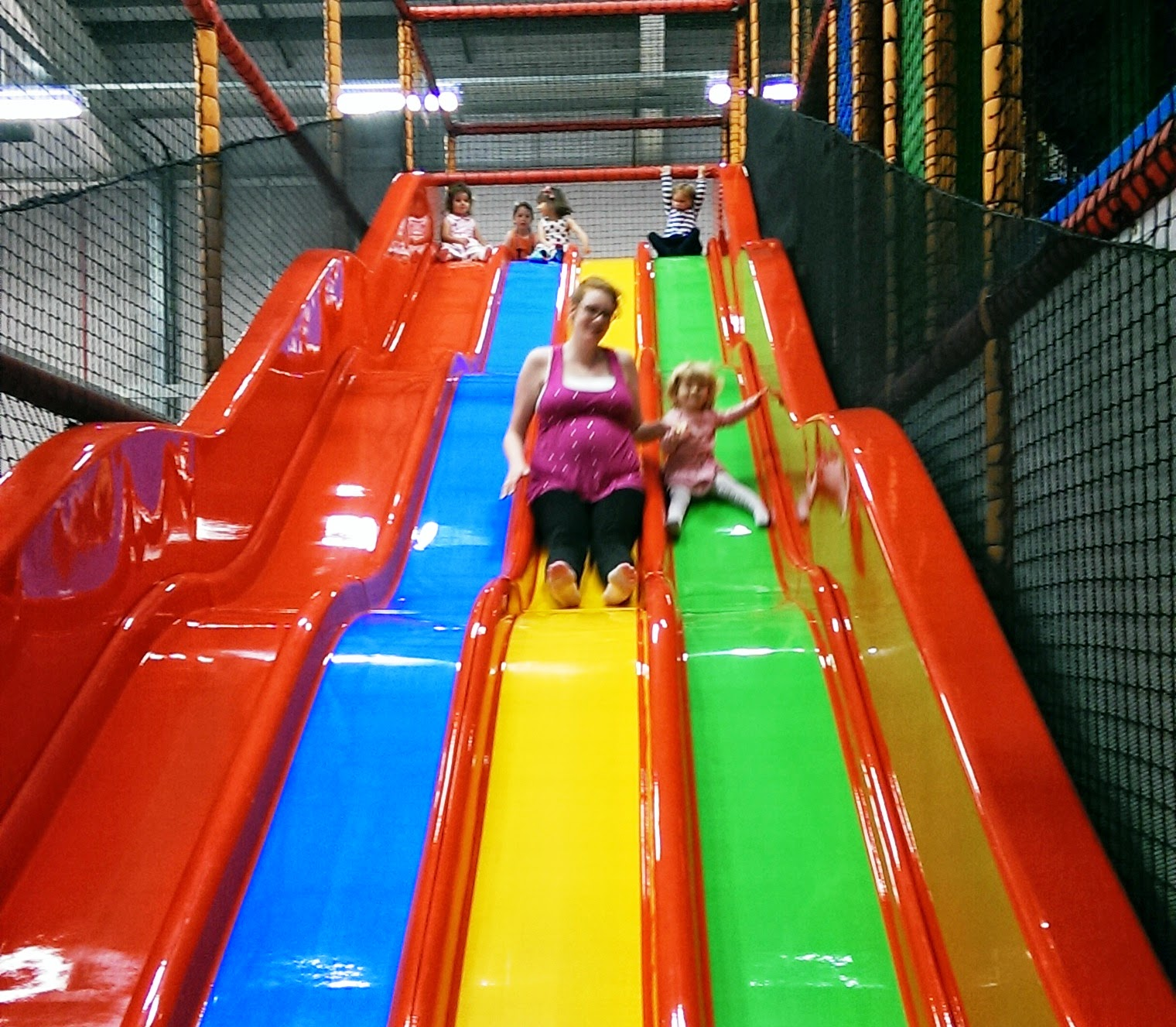 Mum and Eva on the slide at softplay