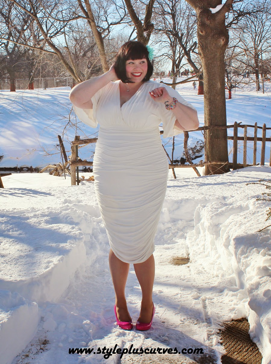 Amber from Style Plus Curves in a plus size white dress from Kiyonna in the snow