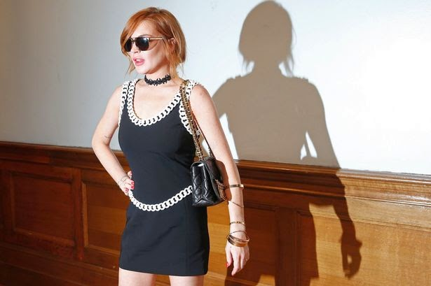 Lindsay Lohan arrives for the presentation of the Moschino collection