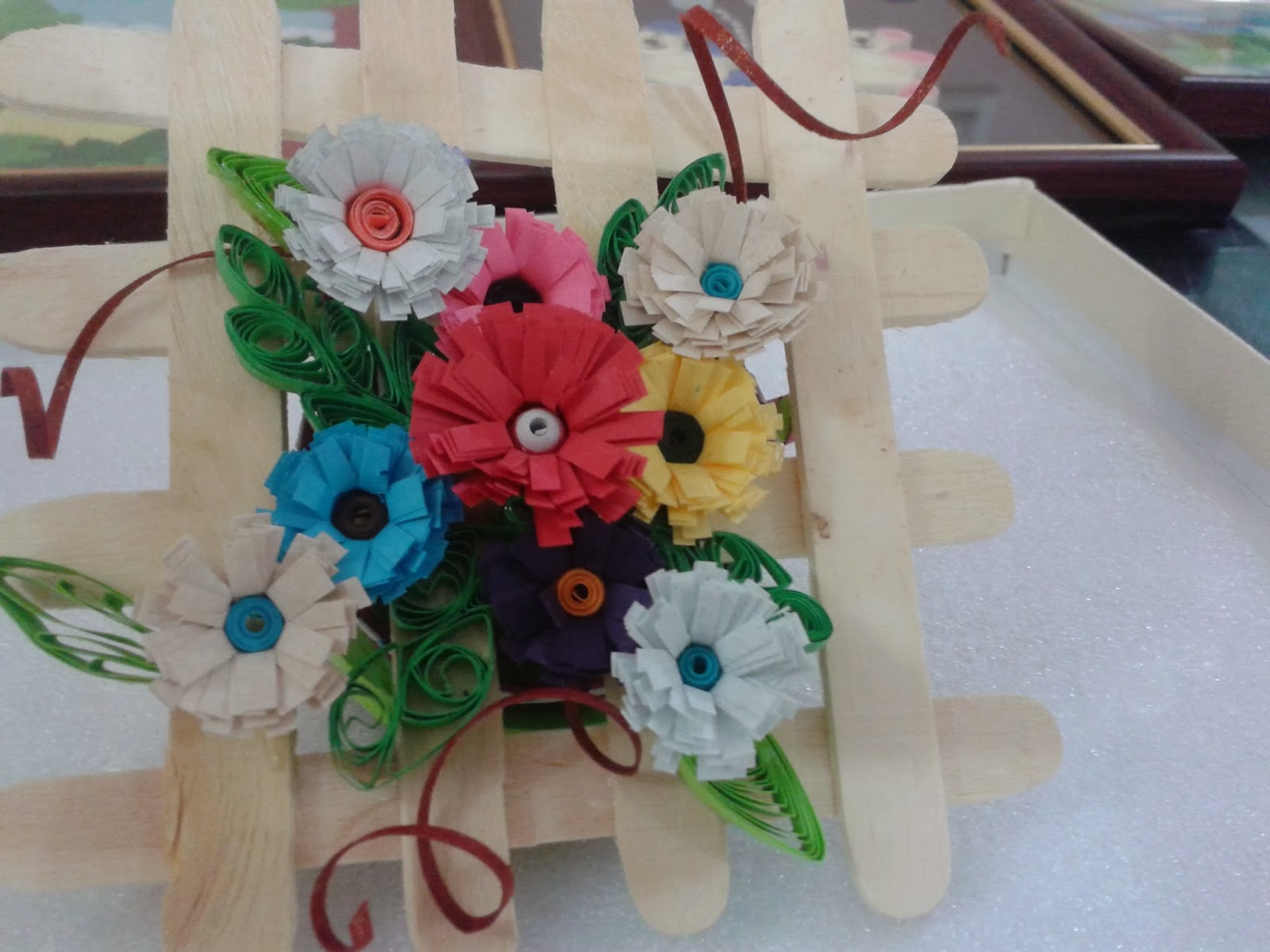 Paper craft and quilling paper quilled flower bouquet for christmas on top of the basket arrange the flowers like a heap and fix the leaves and petals in sides and gaps izmirmasajfo