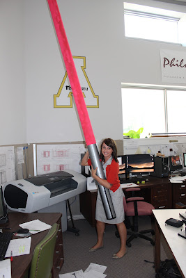 Jen holding a giant light saber like a true Star Wars fan!