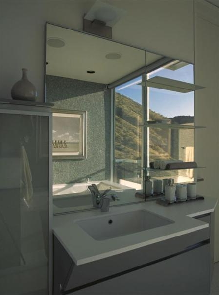 Photo of sink and the mirror in modern bathroom