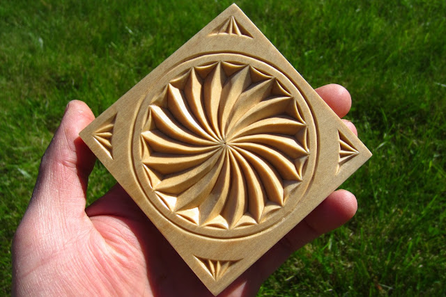Ales the woodcarver swirl rosette coaster