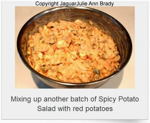 spicy potato salad in mixing bowl