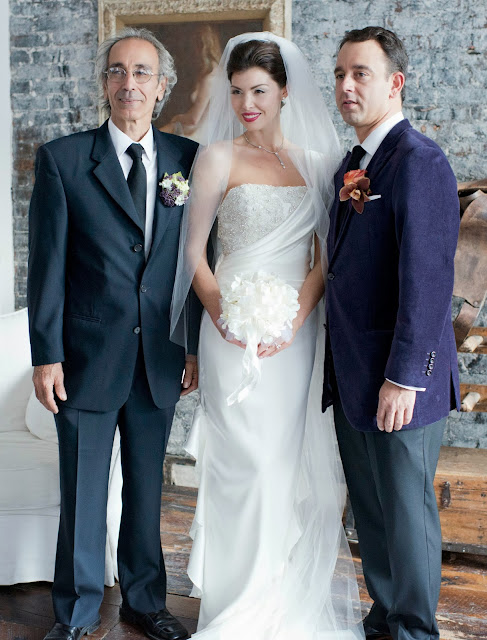 A Model Wedding, formals with bride, groom and dad.