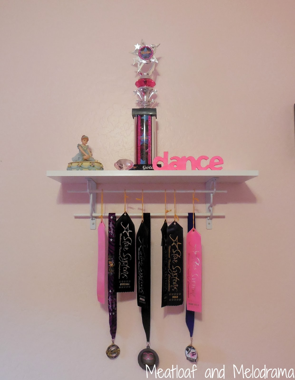 trophy shelf, medals, dance awards