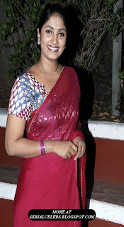 Anchor Jhansi in red saree