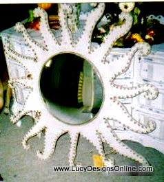 large white sun shape mirror with textured dots