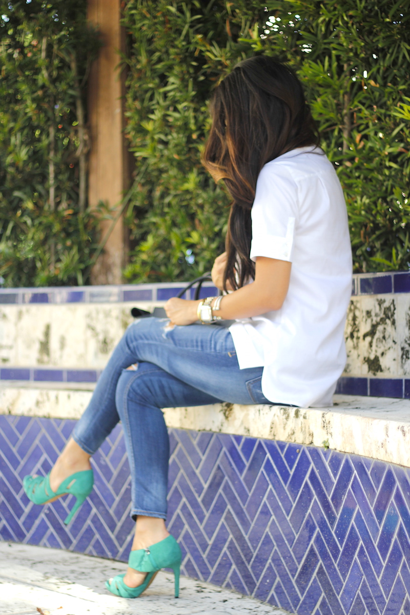 green heels, jeans and white blouse