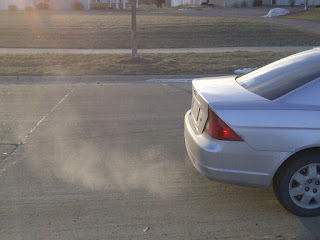 Shows exhaust from car tailpipe