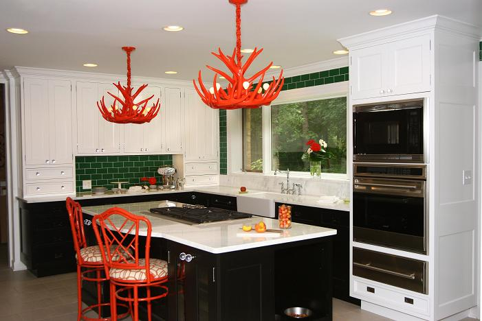 Rustic ventures modern antler chandeliers these orange antler chandeliers demand attention while keeping this kitchen ultra modern and sleek mozeypictures Images