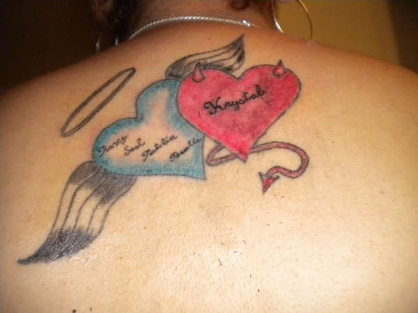 Heart of an angel and demon heart tattoo