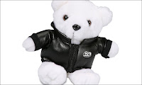 toy bear wearing a jacket