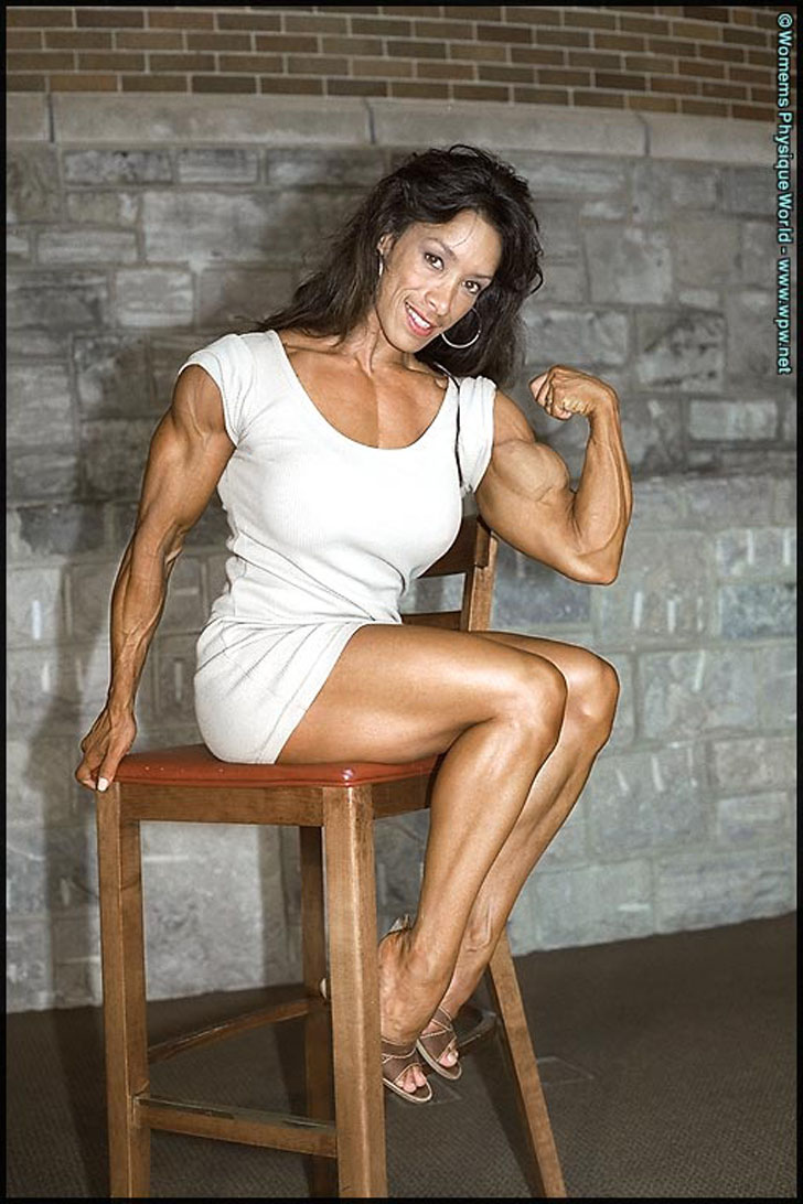 Denise Masino Flexing A Bicep In A White Dress