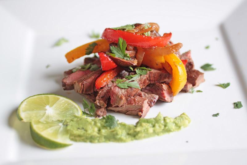 process top steak with fajita vegetable medley garnish with chopped ...