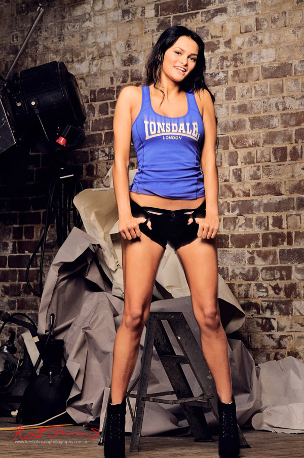 Sportswear shot 'Jumping' Lonsdale London Singlet and black denim shorts and lace up boots.