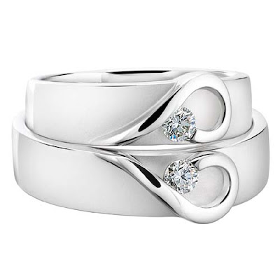 some modern wedding rings contain precious stones other than the ever popular white diamond the diamond found its way onto the wedding ring because of its - Modern Wedding Rings
