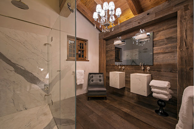 Picture of luxury bathroom with marble and wooden furniture